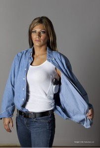 "Morgan showing off her J-Frame ""Ladysmith"" revolver in a Concealment-T t-shirt, image 004"